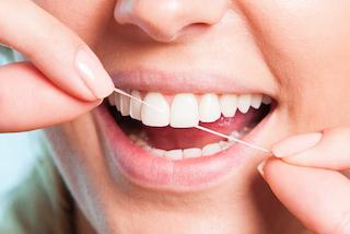 woman flossing | casuarina general dentist