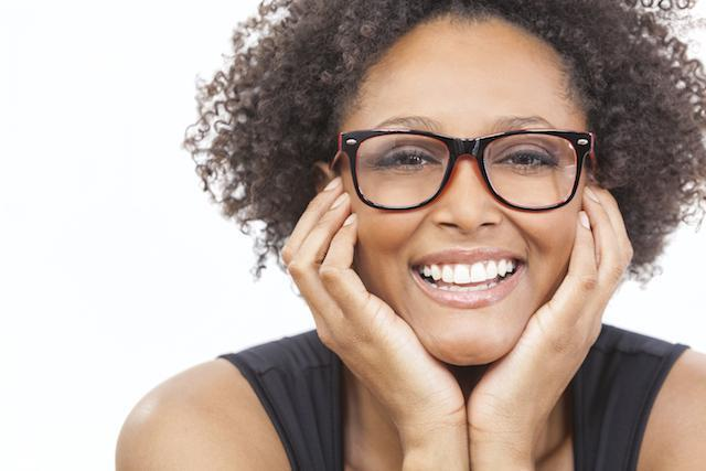 a woman with glasses smiles | tooth colored dentistry in northern suburbs nt