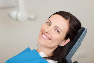 a woman smiles in the dental chair | emergency dentist casuarina nt