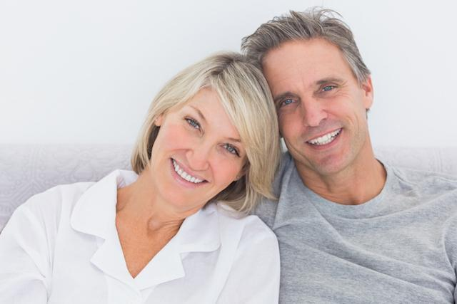 couple smiling after periodontal treatment