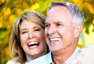 Older couple smiling outdoors | darwin nt dental implants