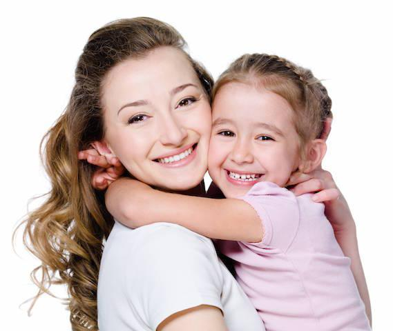 a mother and her child smile in front of a white backdrop | children's dentist casuarina nt