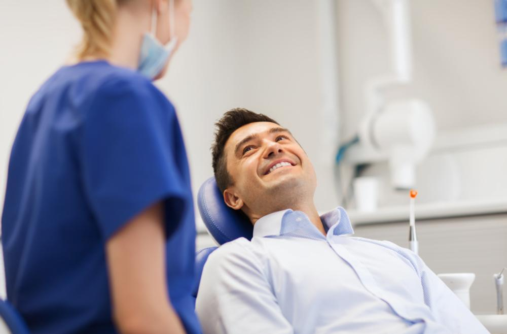 a man smiles in the dental chair | dentist in casuarina nt