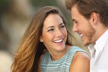 Young couple smiling & laughing l cosmetic dentist casuarina