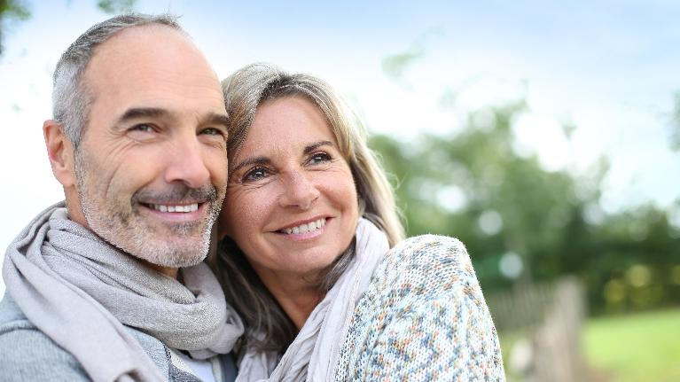 Happy older couple sitting together | Dental Implants Darwin NT