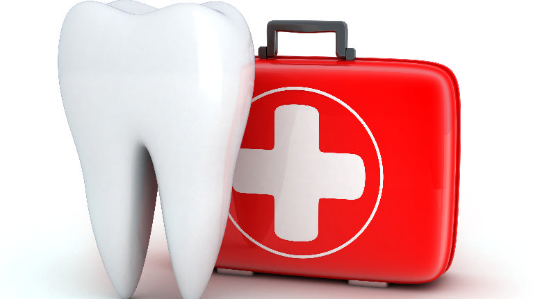 a tooth in front of a first aid kit | Emergency Dentistry Casuarina Square NT