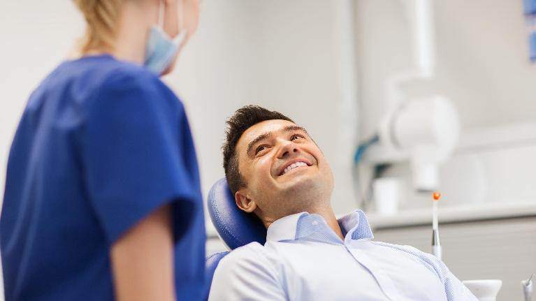 A Man Smiling in A Dental Chair | Darwin Dentist