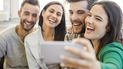 woman taking selfie with friends