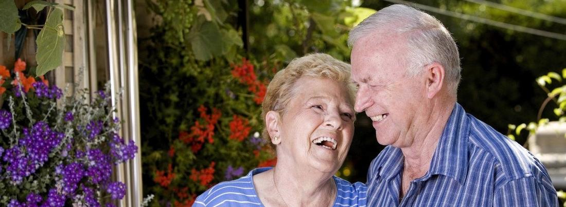an older couple laughs together | dental implants casuarina nt