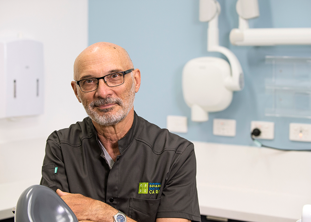 Dr. George Vlanzy smiles in our casuarina office | dentist in Casuarina nt